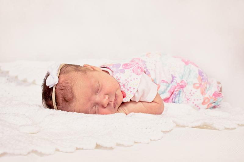 2 week old baby girl sleeping