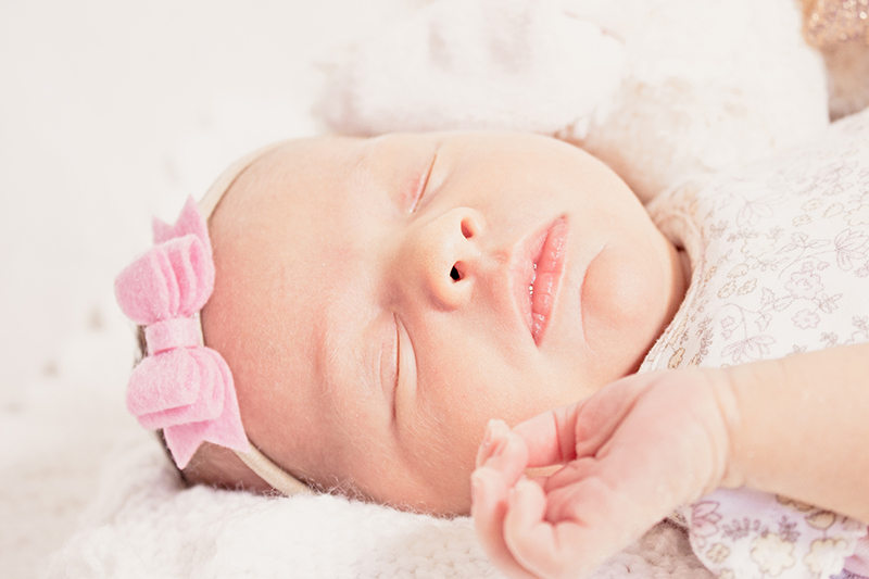 Close up of the face of a 2 week old baby girl.