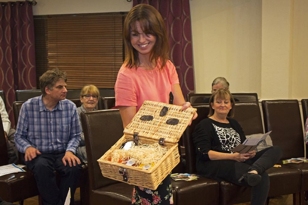 One of the items being presented, a wicker basket full of cheese.