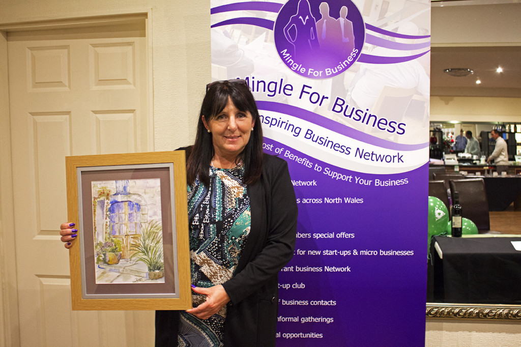 Sandra with her auction item she won.