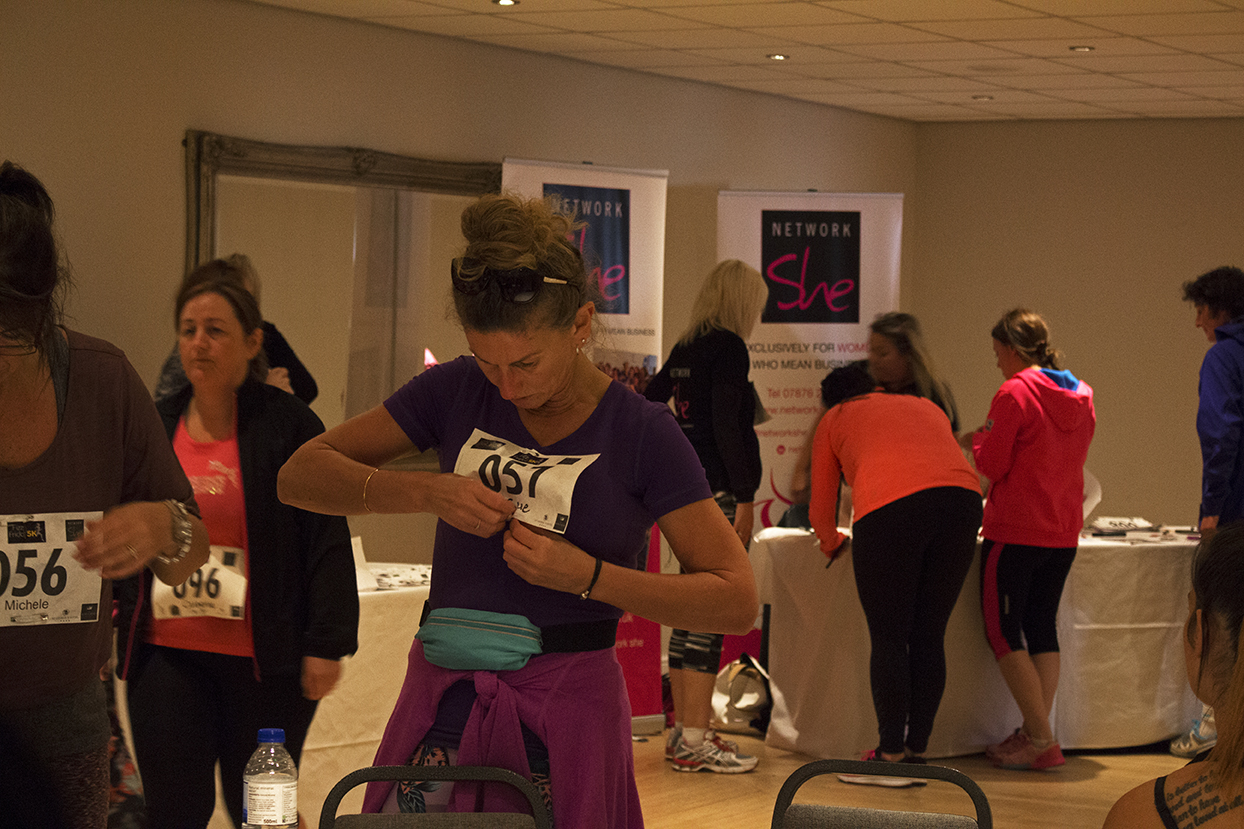 One individual getting her number on before she has some prosecco for the run.
