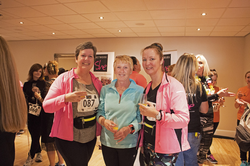 Three of the runners posing with their prosecco before they head for the start line.