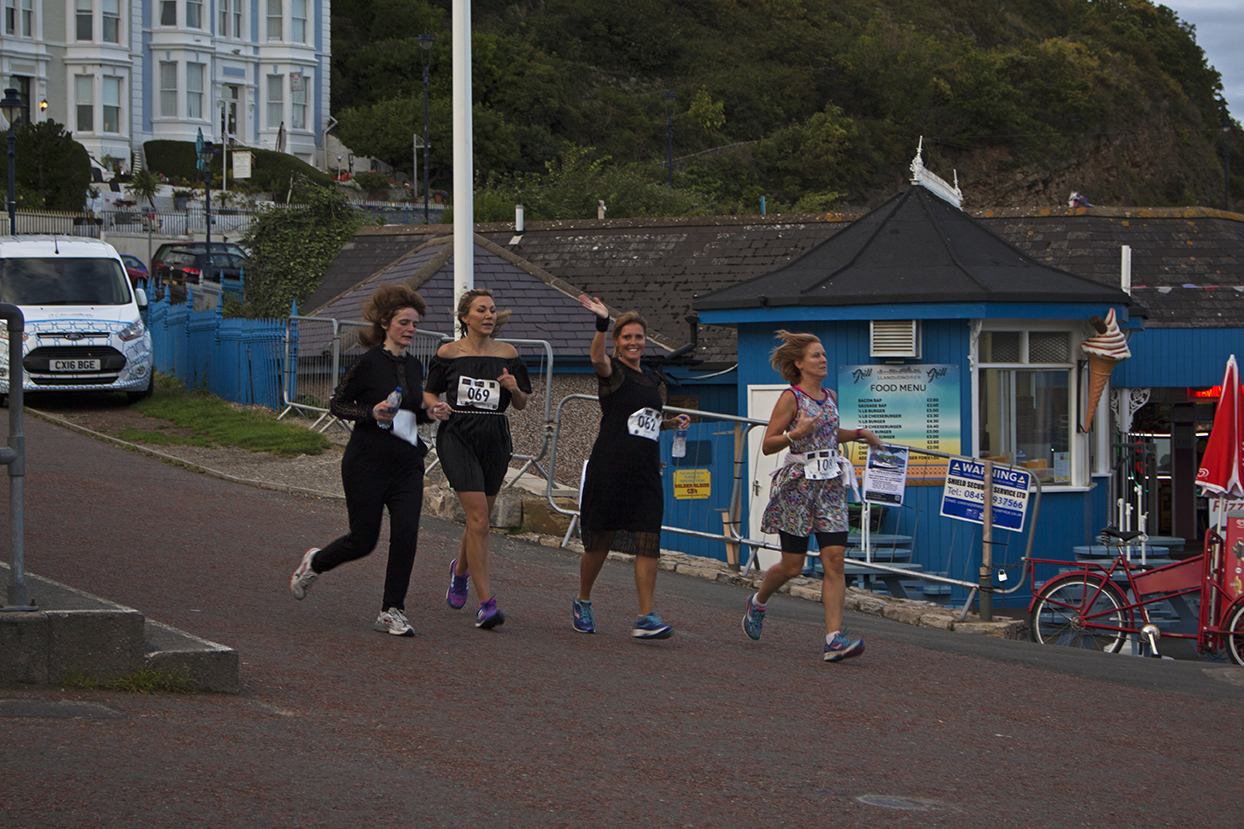 A group of ladies running the 5k in dresses.