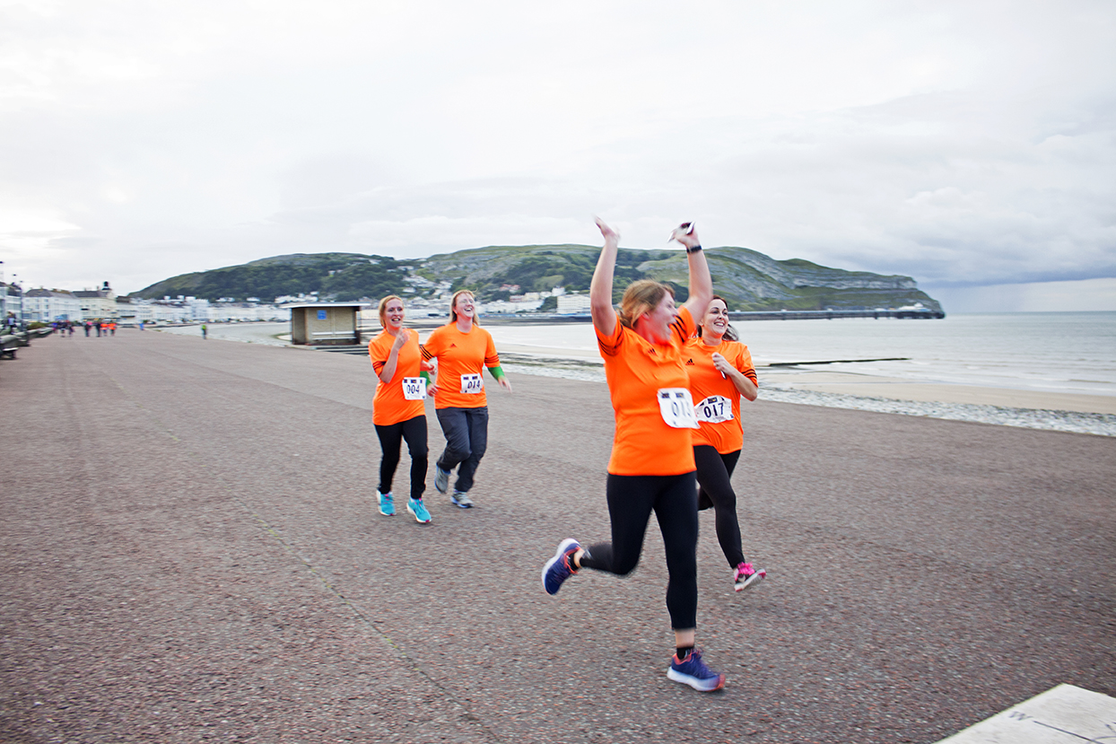 Some of the Llanddulas Lions coming over the finish line.