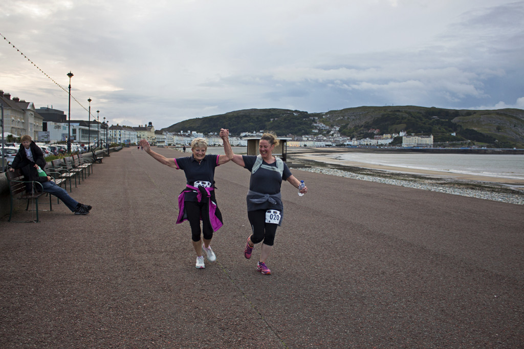 Some more runners crossing the finishing line.
