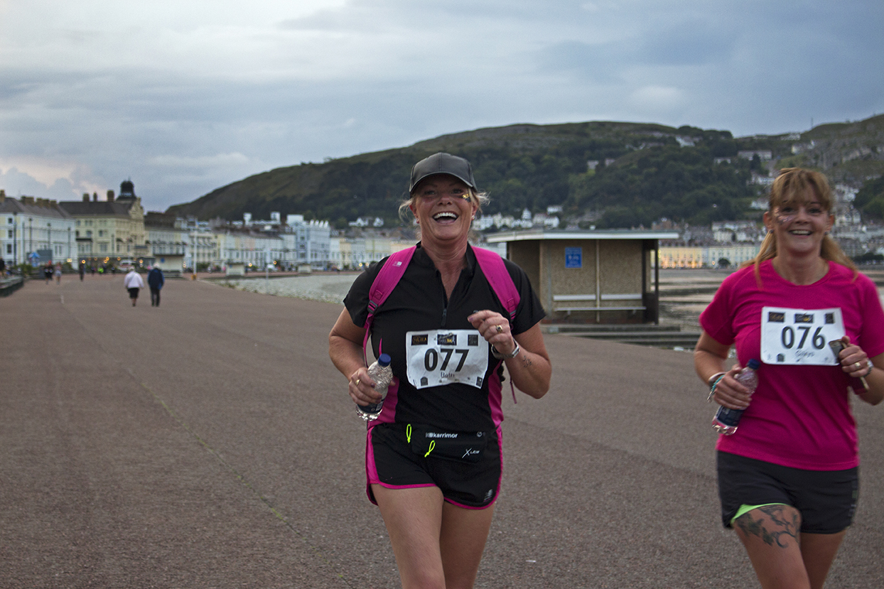 One individual coming to the finish line with a big smile of her face.
