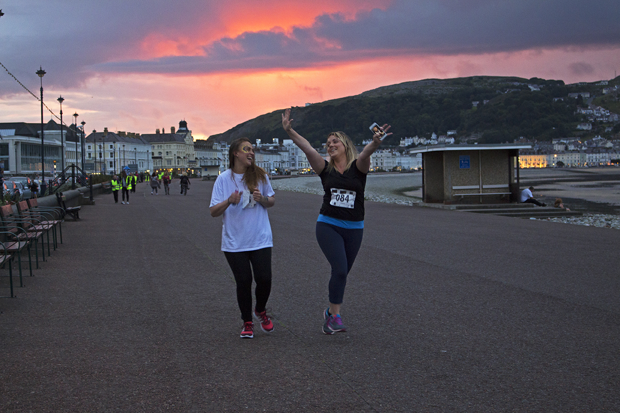 Two lovely ladies fueled with prosecco coming to the finish line.