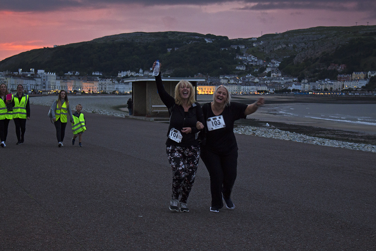 The last two ladies coming across the finish line to end the 1st Fizzy Friday 5k.